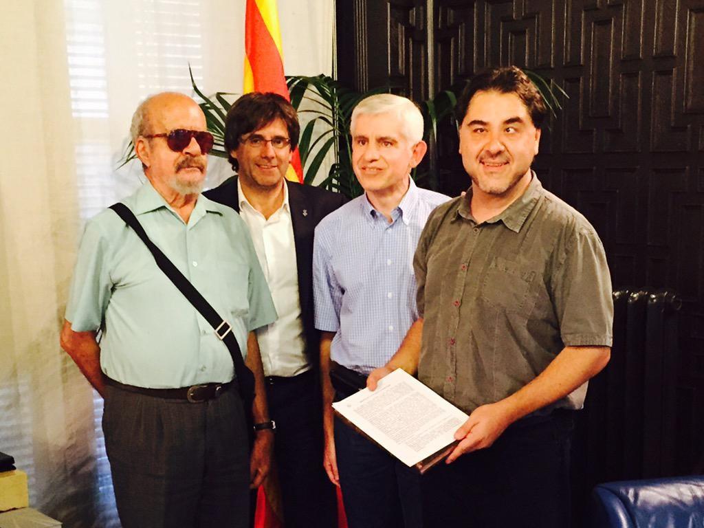Els responsables de Cecs.cat i l'AMI, a Girona